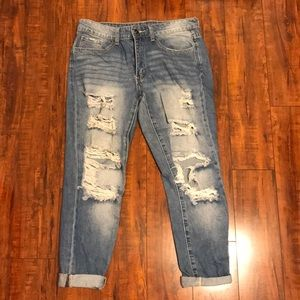 Women's jeans with distress holes/details